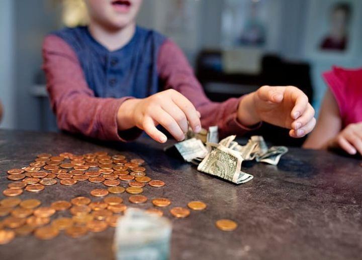 留学家长应培养孩子的金钱观